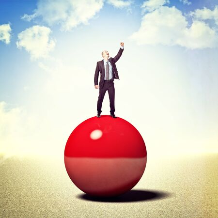 smiling businessman on 3d red ball Stock Photo - 16719386