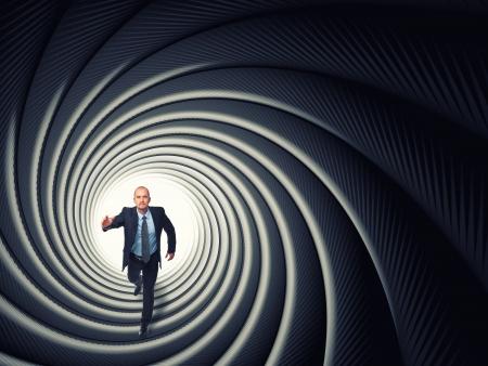 businessman run inside a gun pipe Stock Photo - 16885105