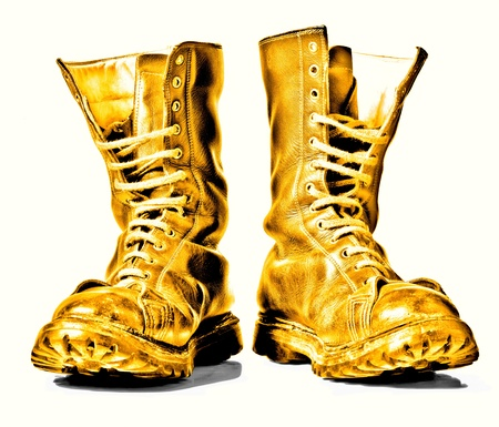 combat boots:  golden  combat boots isolated on white background Stock Photo