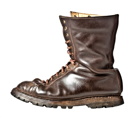 hiking boots: isolated used combat leather boots Stock Photo
