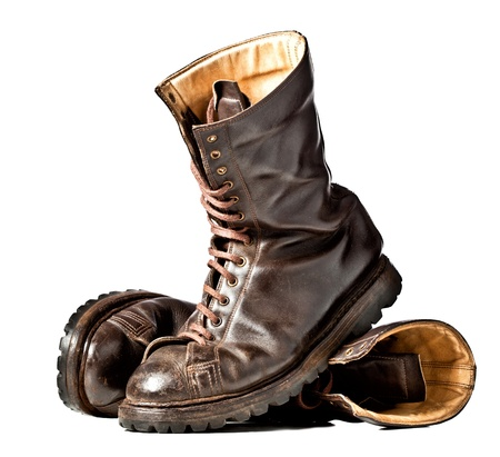 combat boots: isolated used combat leather boots Stock Photo