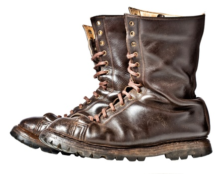 isolated used combat leather boots photo