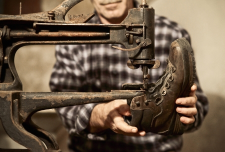 cobbler at work with sewing machine Stock Photo