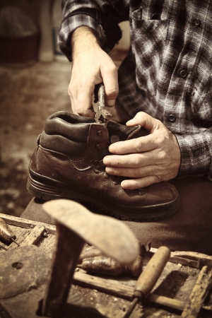 cobbler at work with old tools photo