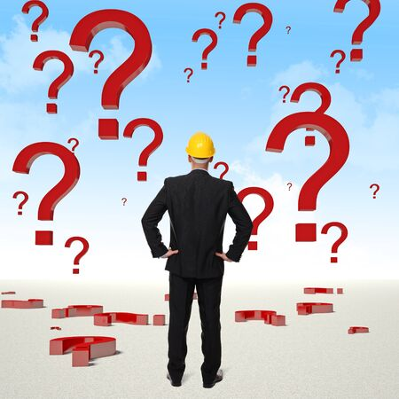 standing engineer and question mark in the sky Stock Photo - 17235431