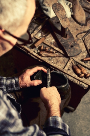 repairer: cobbler at work with old tools