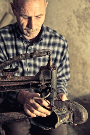 cobbler: cobbler at work with old tools