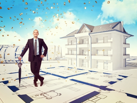 smiling businessman and 3d house with money rain photo