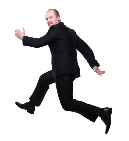 businessman jumping: isolated businessman in running pose
