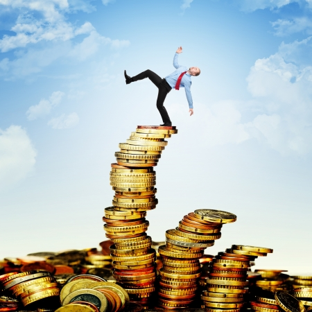 proble: worker is going to fall from euro coin pile Stock Photo