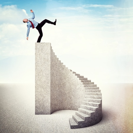 fall down: man on stair near to fall down