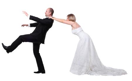 atrapar: gromm tratar de escapar de la boda Foto de archivo
