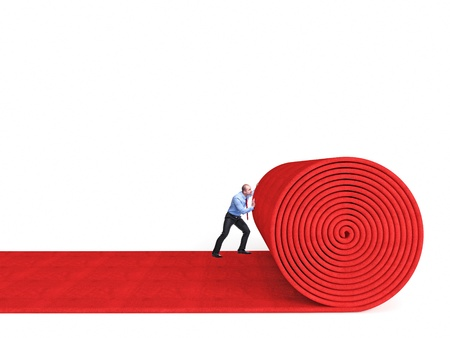 man roll huge red carpet isolated on white  photo