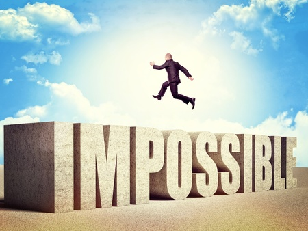 man jump over impossible concrete word Stock Photo - 17602291