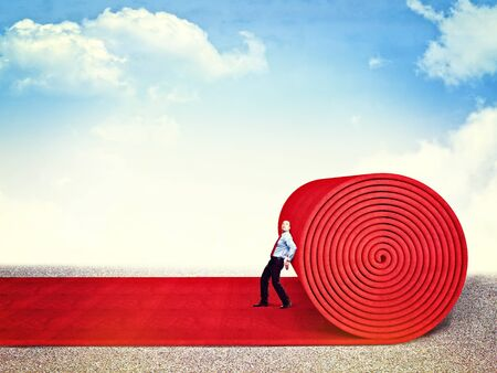 man roll huge red carpet Stock Photo - 17602281