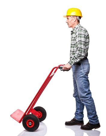 handtruck: senior carpenter with handtruck on white