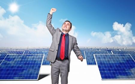 solarpanel: happy businessman and solar panel background