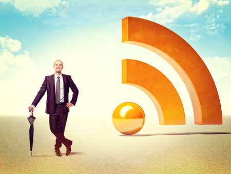 smiling businessman and 3d huge rss logo photo