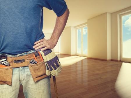 handyman tools: closeup image of handyman at home