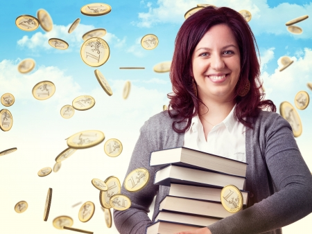smiling woman with books and euro rain photo