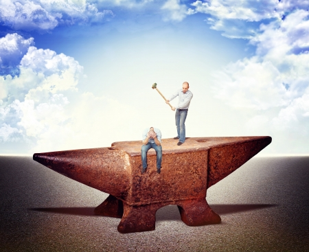 men on iron anvil and sky background photo