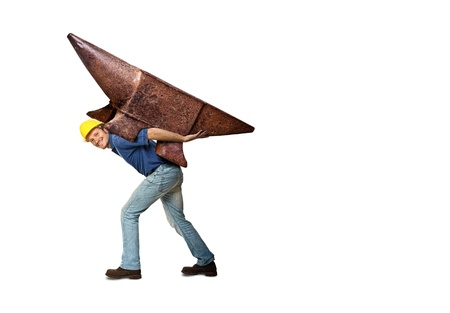 isolated handyman carry huge anvil right copyspace photo