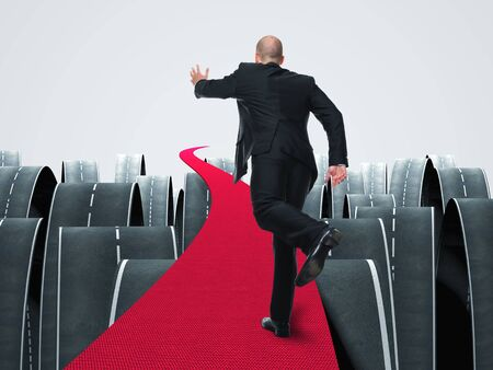different concept: man run on 3d red carpet abstract background