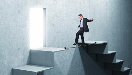 businessman balanced on 3d rope