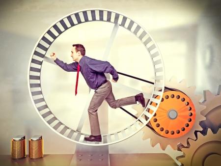 Geschäftsmann in riesigen Hamsterrad laufen Standard-Bild - 22505193