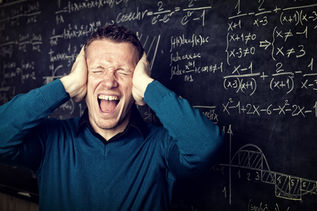 maths: stressed teacher portrait and blackboard background