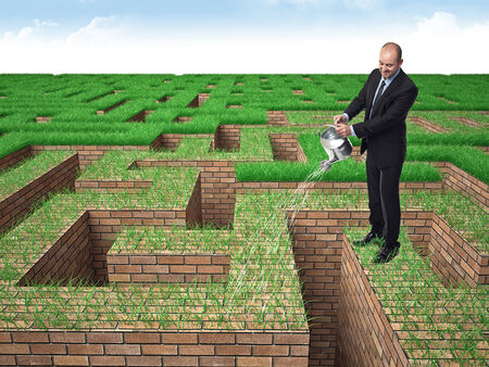man water grass on brick maze Stock Photo - 23222140