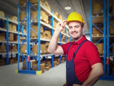 craftman: portrait of caucasian handymanand warehouse background Stock Photo