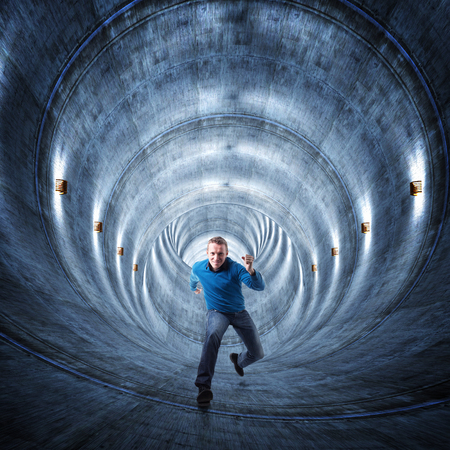 proble: 3d image of concrete tunnel and running man Stock Photo
