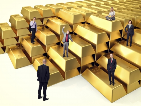 business people on 3d gold ingot photo