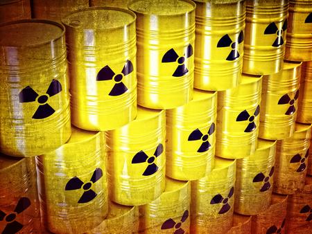 residuos toxicos: fondo de barel amarillo 3d y signo radiactivo Foto de archivo