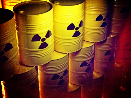nuclear safety: background of 3d yellow barel and radioactive sign