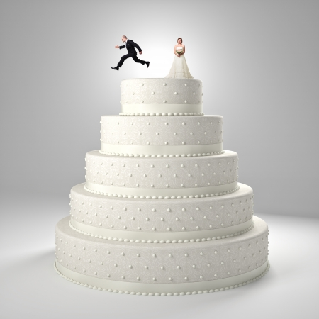 classic wedding cake with groom and bride Stock Photo