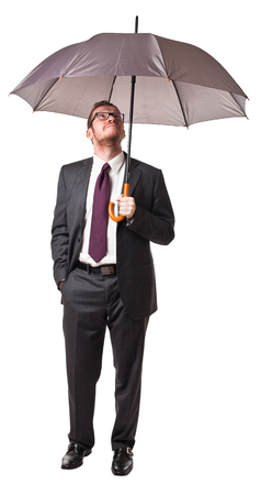 businessman with umbrella isolated on white photo