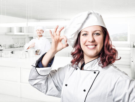 smiling young woman chef portrait photo