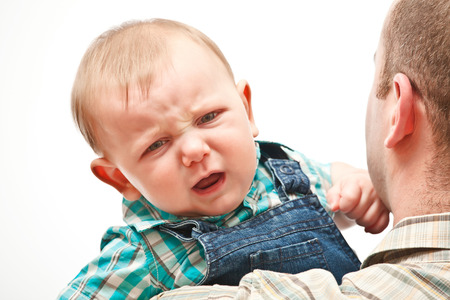 angry baby: portrait of angry caucasian baby