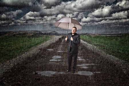 proble: sad businessman and rainy day