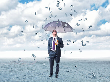 businessman with umbrella and question mark rain photo