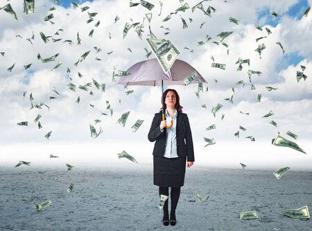 money rain: businesswoman with umbrella and money rain Stock Photo