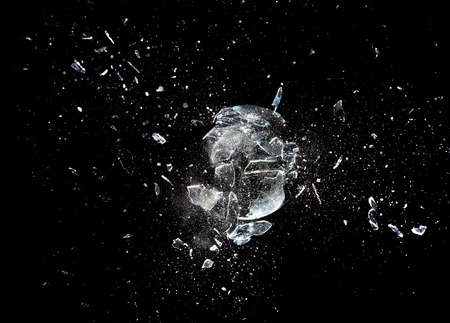 broken glass: close up image of glass ball  explosion