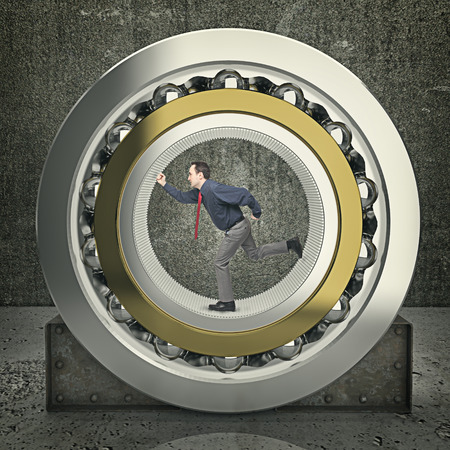 ball bearing: man run inside of huge ball bearing