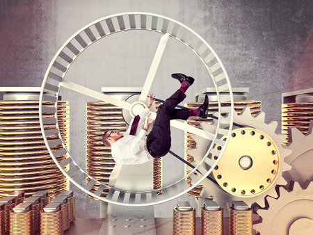 copper wire: businessman fall in a huge hamster wheel Stock Photo