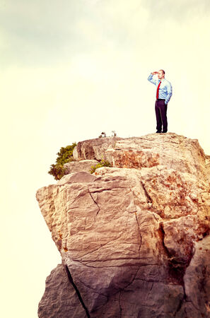 standing man on rock natural cliff Stock Photo - 29917738
