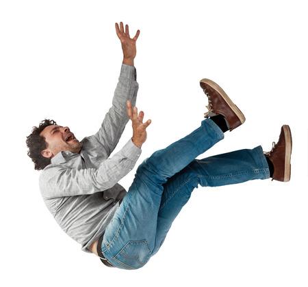 hombre cayendose: la caída del hombre aislado en el fondo blanco