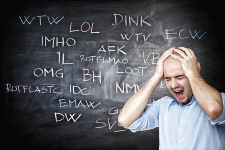 slang: stressed man and internet slang on blackboard