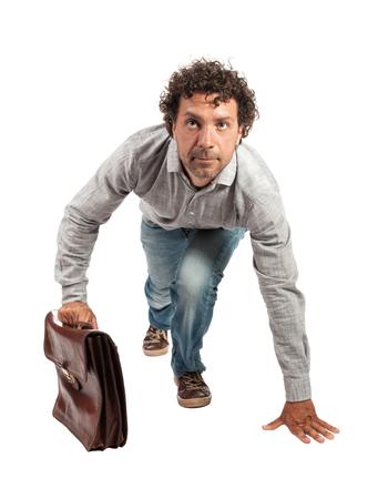 start position: businessman in start position isolated on white